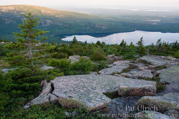 Sunrise on the peak of Sargent Mountain in Acadia National Park